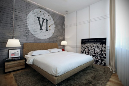fabric bed in modern bedroom with roman numerals on wall above bed