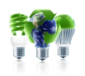 three lightbulbs in green one with world globe and recycle arrows