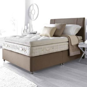 kingston 10800 pocket sprung divan bed a deep luxury pillow top tufted mattress finished in a cream damask on a mushroom coloured base with matching fabric headboard in a room setting - Sussex beds