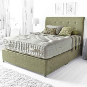 knightsbridge 10800 pocket sprung divan bed, deep cream damask covered tufted mattress with triple side stitched border with matching green base and green buttoned headboard in room setting - Sussex Beds