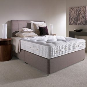 luxury bed in bedroom with grey base