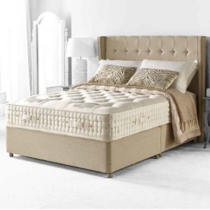 mayfair 15800 pocket sprung divan bed, deep hand tufted mattress in cream damask cover on mushroom coloured divan base with matching buttoned headboard in room setting - Sussex Beds