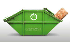 large green skip with mattress inside