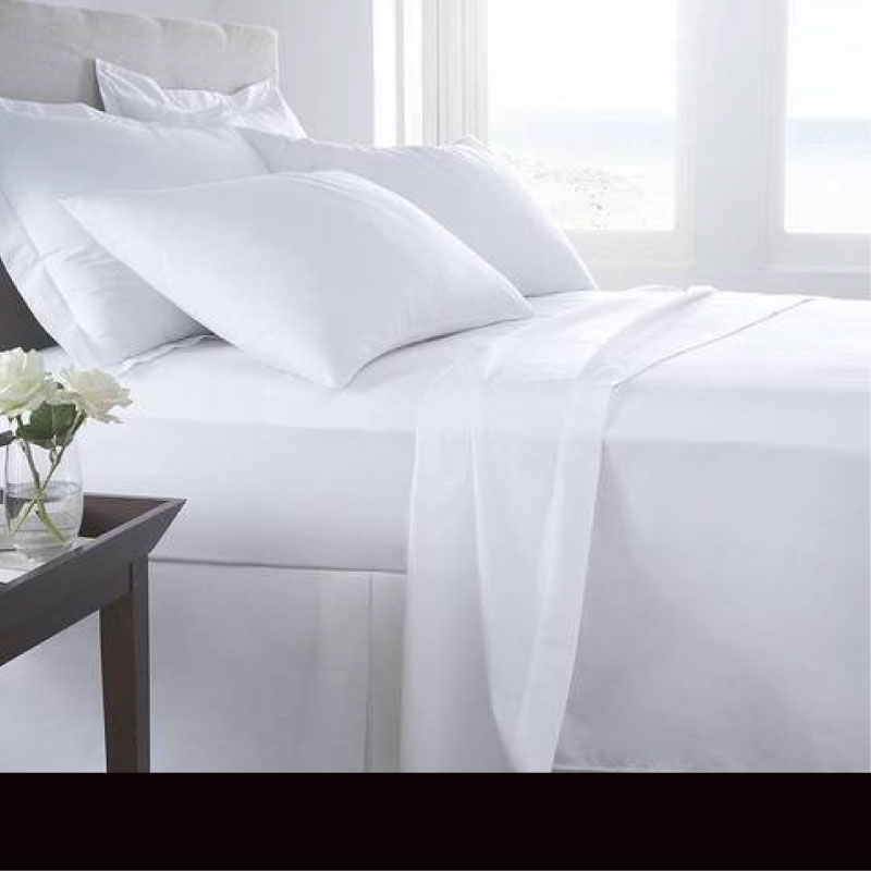 Bedding - white bed linen on a bed - Sussex Beds