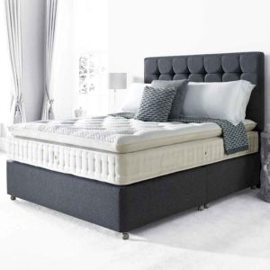 chelsea 8200 pocket sprung divan bed deep pillow top tufted mattress in cream fabric on dark grey divan base with matching buttoned headboard in room setting - Sussex Beds