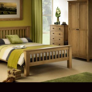 Felbridge oak bedroom furniture collection - Sussex Beds - oak bed frame, shaker design with high foot end in bedroom setting with matching 2 door wardrobe and 4 + 2 chest